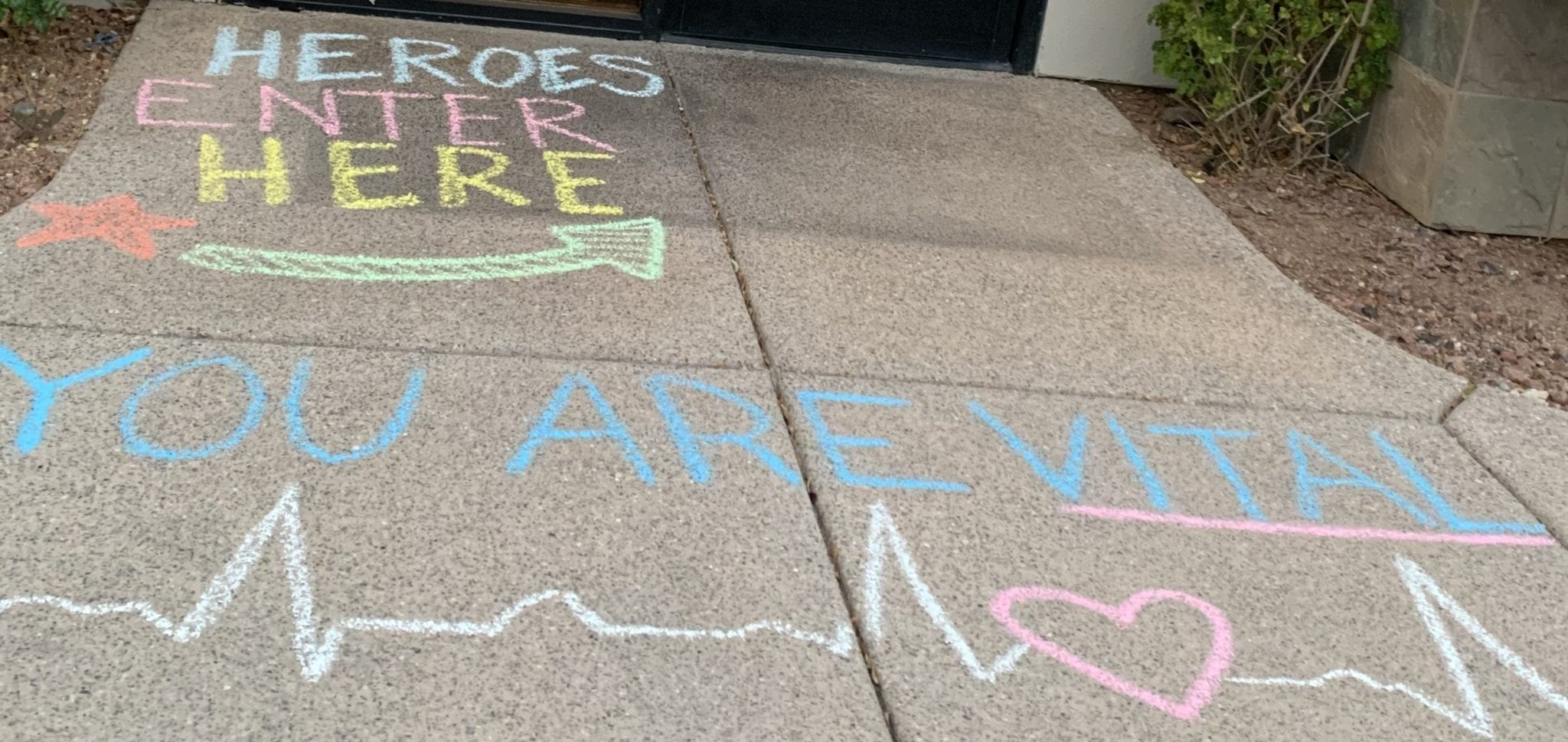 Sidewalk chalk expressing appreciation for healthcare workers