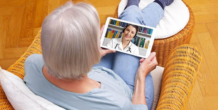 Senior woman having telemedicine visit with doctor