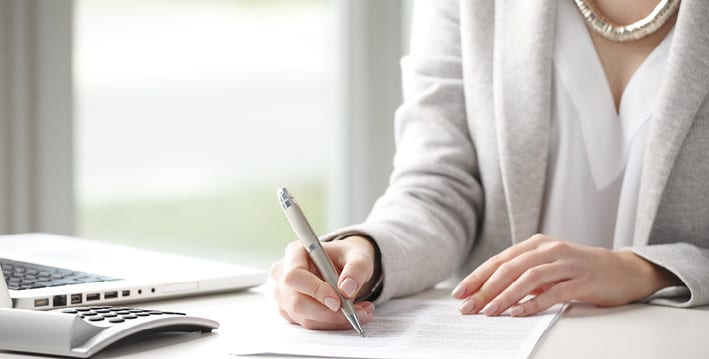 woman completing her advanced directive paperwork