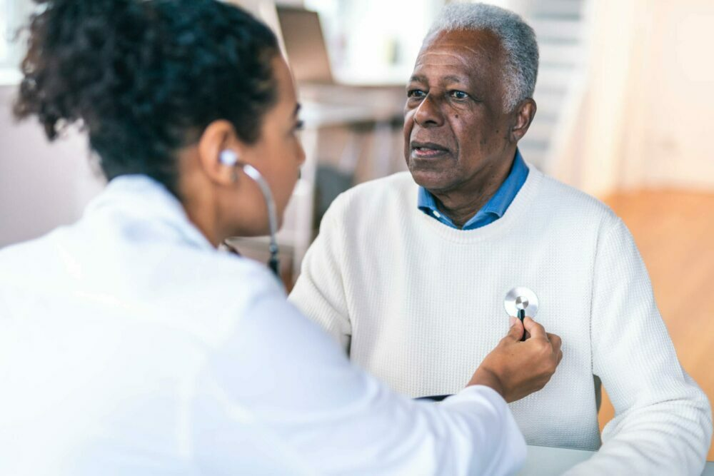 elderly man getting a heart wellness checkup with doctor